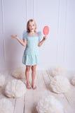 Kid girl with lollipop Stock Photos