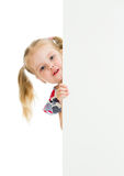 Kid girl looking out of blank banner poster stock image