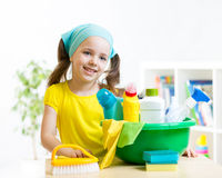 Kid girl make cleaning in the children room at Royalty Free Stock Photo