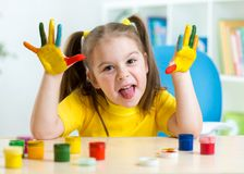 Kid girl making a funny face with both hands Royalty Free Stock Photography