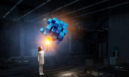 Innovative impressive technologies. Kid girl and media cube figure as symbol for technologies. 3d rendering Stock Photography
