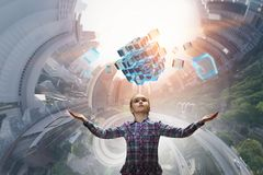 Innovative impressive technologies. Kid girl and media cube figure as symbol for technologies. 3d rendering Royalty Free Stock Image