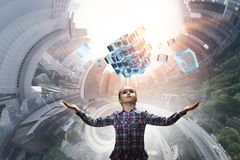 Innovative impressive technologies. Kid girl and media cube figure as symbol for technologies. 3d rendering Royalty Free Stock Photos