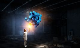 Innovative impressive technologies. Kid girl and media cube figure as symbol for technologies. 3d rendering Stock Images