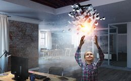 Innovative impressive technologies. Kid girl and media cube figure as symbol for technologies. 3d rendering Stock Photos