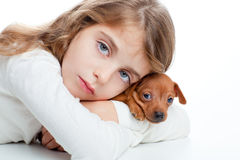 Kid girl with mini pinscher pet mascot dog Royalty Free Stock Image