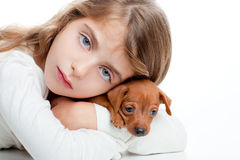 Kid girl with mini pinscher pet mascot dog Royalty Free Stock Images
