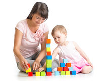 Kid girl and mom play with building blocks Royalty Free Stock Image