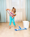 Kid girl with mop Stock Images