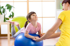 Kid girl and mother do gymnastics with fitness ball. Child girl and mother do gymnastics with fitness ball Stock Photos
