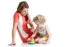 Kid girl and mother play with colour toys Royalty Free Stock Photos