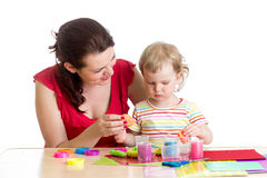 Kid girl and mother playing colorful clay toy Stock Photography