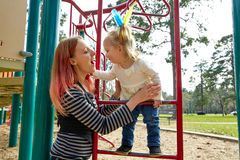 Kid girl and mother playing playground ladder Royalty Free Stock Photography