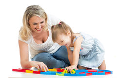 Kid girl and mother playing together Stock Photos