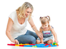 Kid girl and mother playing together Royalty Free Stock Photography