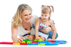 Kid girl and mother playing together Royalty Free Stock Photo