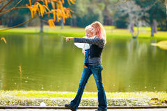 Kid girl and mother walking in the park lake Royalty Free Stock Photos