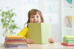 Kid girl with open book Royalty Free Stock Image