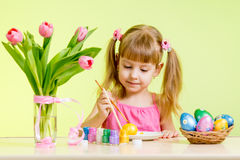 Kid girl paint Easter eggs Royalty Free Stock Photography