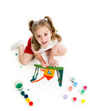 Kid girl is painting. Top view. Royalty Free Stock Image
