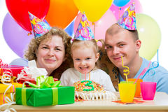 Kid girl with parents on birthday Royalty Free Stock Image