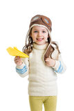 Kid girl pilot playing with paper airplane Stock Photo