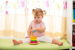Kid girl play with colorful toy at home Royalty Free Stock Photos