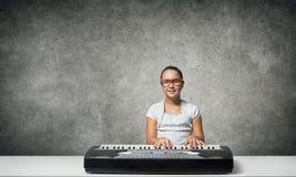 Kid girl play synthesizer Stock Photo