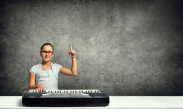 Kid girl play synthesizer Stock Images