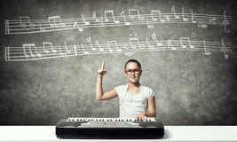 Kid girl play synthesizer Royalty Free Stock Photo
