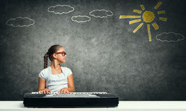 Kid girl play synthesizer Stock Photography