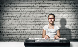 Kid girl play synthesizer Royalty Free Stock Images