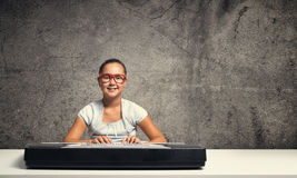 Kid girl play synthesizer Stock Image