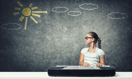 Kid girl play synthesizer Royalty Free Stock Photos