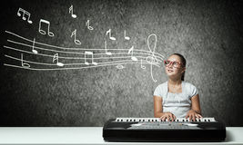 Kid girl play synthesizer Royalty Free Stock Image