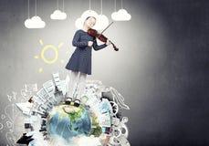 Kid girl play violin Stock Photo
