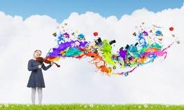 Kid girl play violin Royalty Free Stock Image