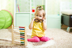 Kid girl playing with abacus, early learning Stock Photos