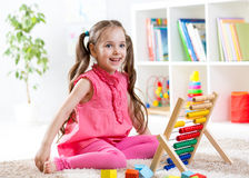 Kid girl playing with abacus Royalty Free Stock Photo
