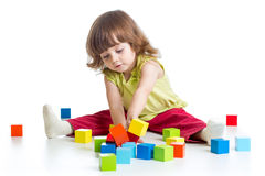 Kid girl playing building block toys Royalty Free Stock Images