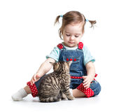 Kid girl playing with cat Royalty Free Stock Photo