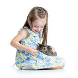Kid girl playing with cat Royalty Free Stock Image
