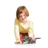 Kid girl playing with cat kitten Stock Photo