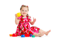Kid girl playing cup toys. Kid girl playing with cup toys royalty free stock images