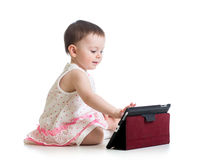 Kid girl playing with a digital tablet royalty free stock photography