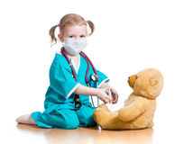 Kid girl playing doctor Royalty Free Stock Images