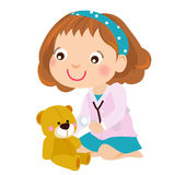 Kid girl playing doctor game with teddy bear Royalty Free Stock Photos