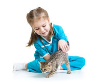 Kid girl playing doctor with kitten Stock Photo