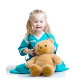 Kid girl playing doctor with plush toy Royalty Free Stock Images