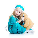 Kid girl playing doctor with plush toy Royalty Free Stock Photography